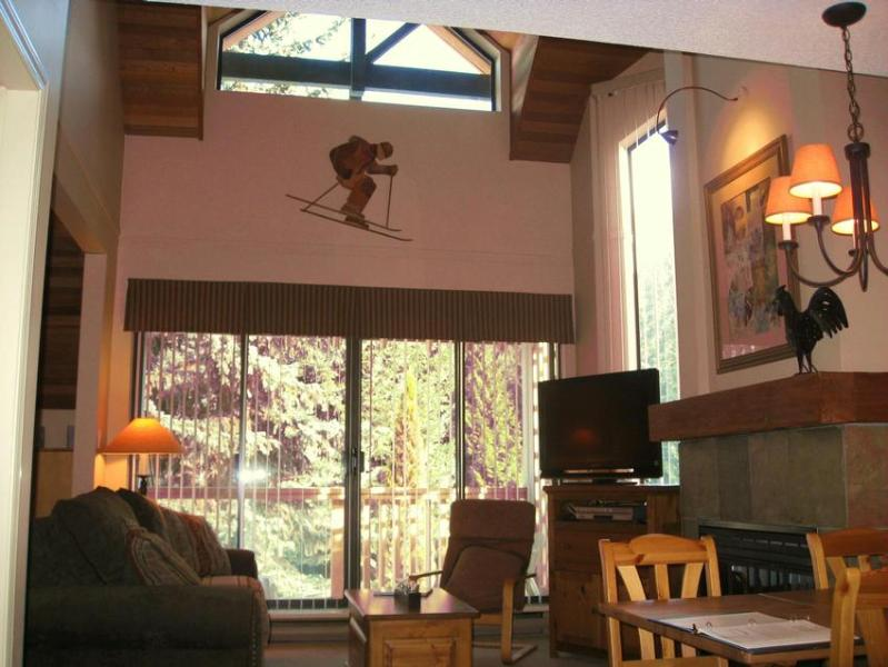 Living Room has vaulted ceiling, fireplace, 37inch LCD TV, sliding glass doors onto deck. Sofabed in living room and wallbed in adjacent open den. - TOP LOCATION - The Gables at Whistler - 1 Bdr & Den, 1.5 baths - Whistler - rentals