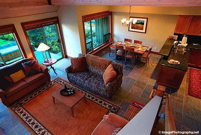 LIVING ROOM: Hemlock Lofted Ceiling (25 ft.), Large Stone Gas Fireplace, Entertainment Center, Heated Slate Floors, and Fabulous Views. Dining Room seats 8 comfortably. - Whistler Condo Rental (Casabella Whistler) - Whistler - rentals