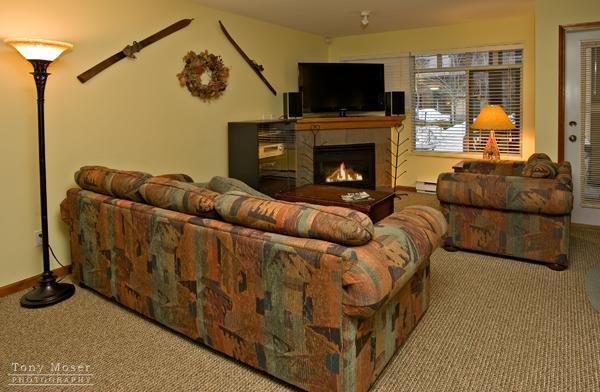 Relax by the fireplace in the comfortable living room with 46inch HD LCD TV with Blue Ray player, stereo and deluxe queen pull out sofa bed - Mark and April Meeks - Whistler - rentals