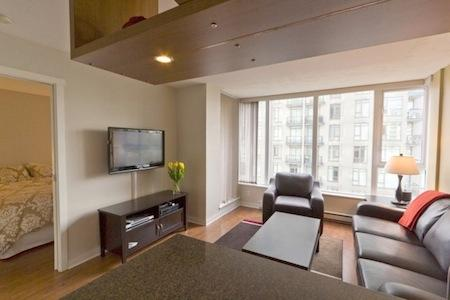 The living area with full cable TV, internet and local phone calls. - Downtown Vancouver 1 Bedroom Yaletown Condo Minutes from Rogers Arena - Vancouver - rentals