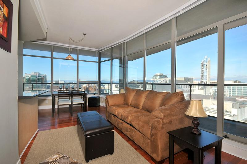 Living room with spectacular city views - Downtown Victoria 1 Bedroom Condo With Sweeping Views of City and Mountains - Victoria - rentals