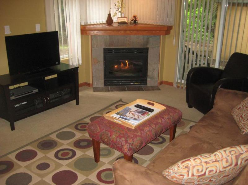 Living room with gas fireplace, new flat screen tv, comfortable seating and double sofa bed. - Unit 6 - Sunpath - Whistler - rentals