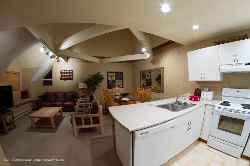 The great room: living, dining and kitchen. Note the vaulted ceiling over the living and dining areas. This is a large and welcoming space for friends and family to gather. - Lake Placid Lodge: Large 4 Bd townhouse by Creekside Gondola, Hot Tub, Pool - Whistler - rentals