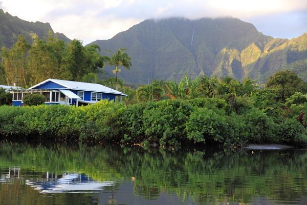 View of the cottage and the mountains while kayaking on the Hanalei river. - Hanalei Dolphin Cottages - TVNC #4346 - Hanalei - rentals