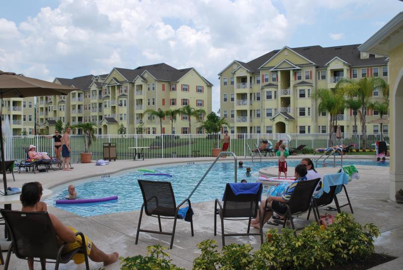 Cane Island Resort Swimming Pool - View 1 - Lakefront Luxury Condominium In Cane Island Resort - Kissimmee - rentals
