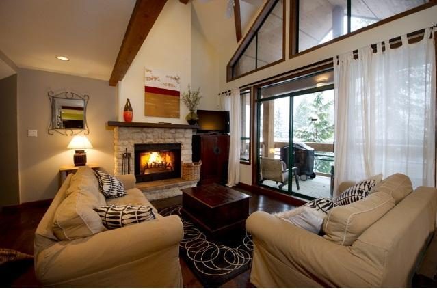 Our spacious and designer decorated living room is great for apres ski socialising around the wood-burning fireplace. - Helen and Simon Waterson - Whistler - rentals