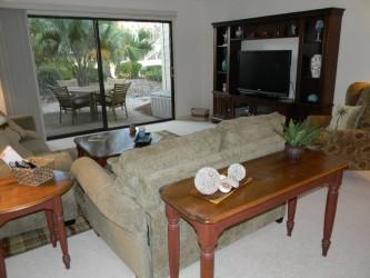 Living Room with Golf Views - 3 BR Luxury Shipmaster Golf Condo Shipyard - Hilton Head - rentals