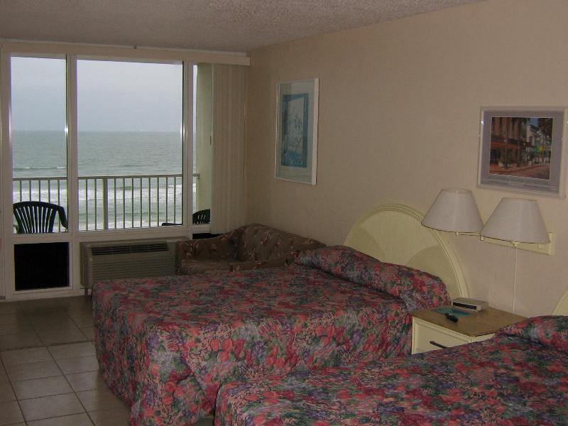 Room beds and sofa bed. - Oceanfront Studio at Pirates Cove - Daytona Beach - rentals