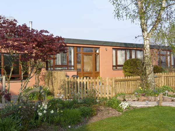 WOODPECKER, pet friendly, country holiday cottage, with a garden in High Head Castle Farm, Ref 4561 - Image 1 - Ivegill - rentals
