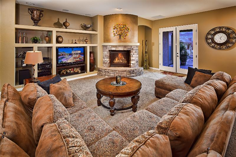 Spacious living room with charming fireplace! - Htd Pool, Hot Tub, Game Room, Sports Court, & More - Cave Creek - rentals