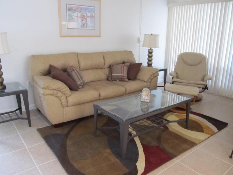 Living room with leather couch and recliner - Quarterdeck Resort Condominium Unit-Venice, FL - Venice - rentals