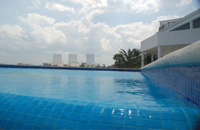 infinity edge Pool view of villa 2nd floor Terrace - NAH HAH - Ocean Front, Private Access to Bay - Akumal - rentals
