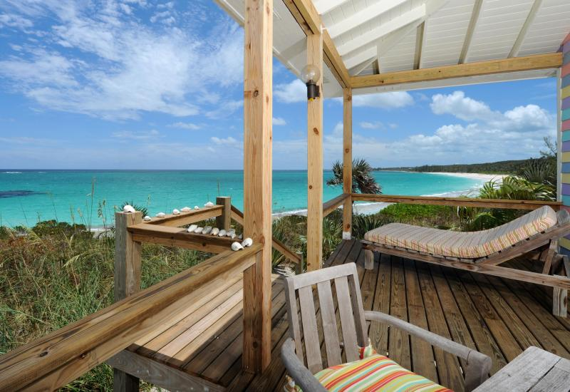 Outdoor dining and lounging deck on the surfside in your one bedroom beach house for 2 people! - Bahamas Cozy Atlantic Eleuthera Romantic Beachfron - Governor's Harbour - rentals