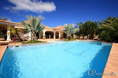 CASA DEL SOL...  A beautiful villa with huge pool, very tropical lot in Orient Bay - Image 1 - Orient Bay - rentals