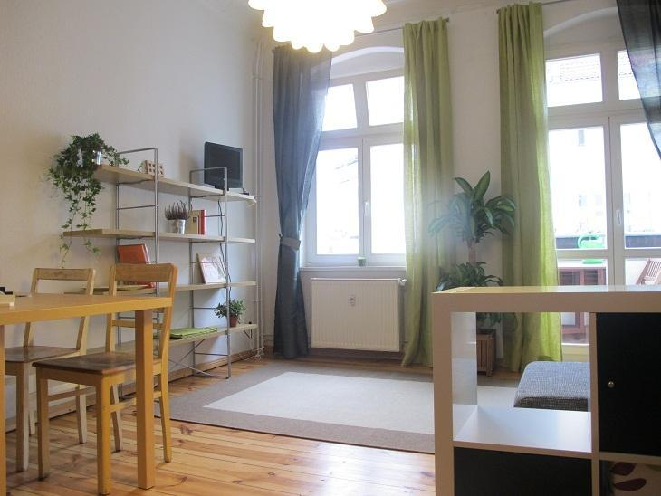 Living rom with sofa bed end kitchen corner - Annas Apartment in Berlin, Bright and Cozy - Berlin - rentals