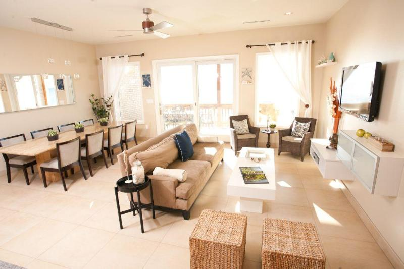 Living and Dining Area - Amazing 6 Bedroom 6.5 Bath Condo Right on the Bay! - South Padre Island - rentals