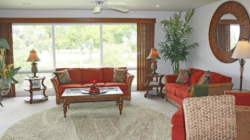 Living Area looking out to Makai Course - Paradise Awaits You In This Luxurious Condominium! - Princeville - rentals