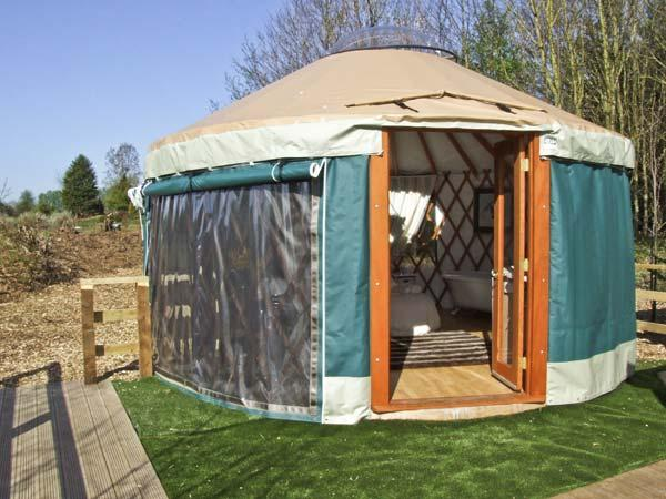 THE LAKESIDE YURT, pet friendly, country holiday cottage, with pool in Beckford, Ref 6017 - Image 1 - Beckford - rentals
