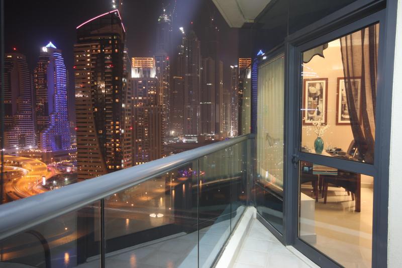 The balcony at night with views over the Marina and the Ocean - 5 mins Metro  Mall, Beach and Restaurants sleeps 6 - Dubai Marina - rentals