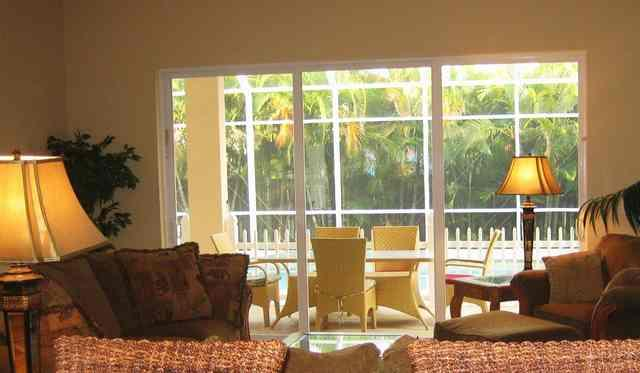 Family room overlooking lanai and pool - Vanderbilt Bch - 4 Br just 1 mile to the beach - Naples - rentals