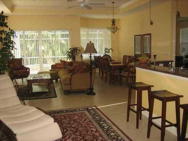 Living area has plenty of seating - DEAL 5/31-6/6 -5 Bdrm $985 - 1 mile to the BEACH - Naples - rentals