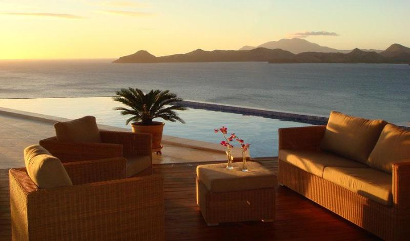 Sunset over the pool and St Kitts - Coccoloba - Nevis - rentals