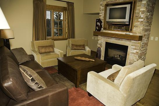 Spacious living room with flat screen TV and fireplace - Lodge 201B Two Bedroom, Two Bath Corner Lodge Condominium. Sleeps 6. WIFI. - Tamarack Resort - rentals