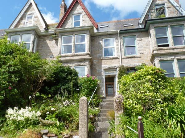 DOLPHINS' WATCH, romantic, character holiday cottage, with a garden in Newlyn, Ref 7472 - Image 1 - Cornwall - rentals