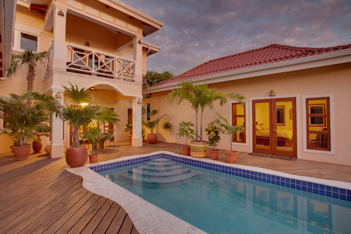 Poolside at twilight. - The Beach Villa - Placencia - rentals