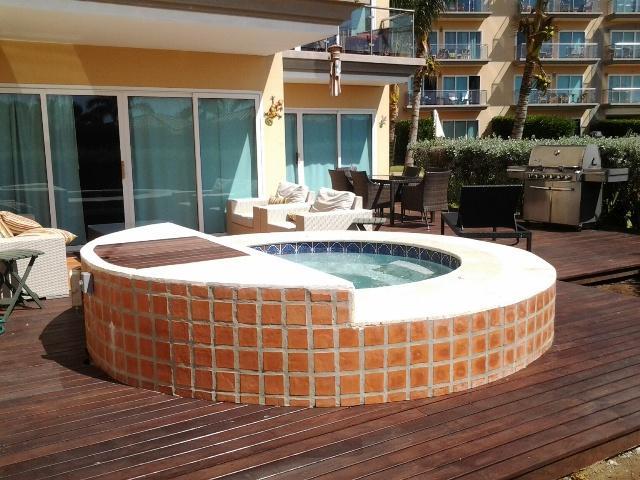 Large roman hot tub on your private decks in your garden! - Garden Delight Three-bedroom condo - E125 - Eagle Beach - rentals