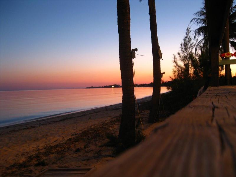 Beach down the road at sunset - Beautiful Bahamas Quiet spacious apt. includes car - Freeport - rentals