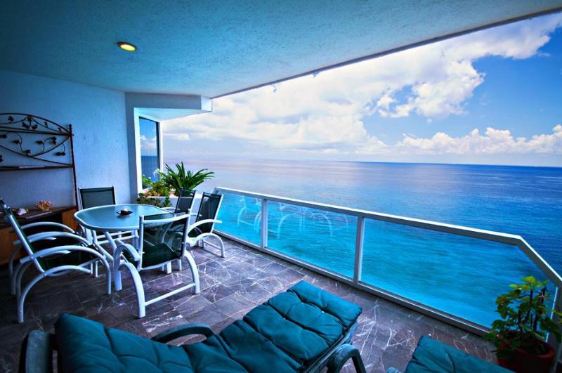 Balcony - MAGNIFICENT OCEAN VIEWS! Puesta del Sol Phase 2, CONDO# 6 North - Cozumel - rentals