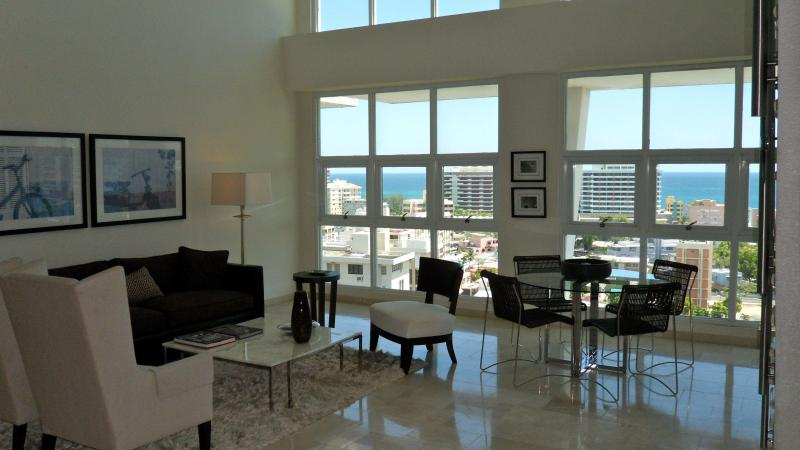 Living/Dining Area with Spectacular Views to the Ocean and the Condado Lagoon. - Luxurious 2 level 3,297 square feet Penthouse - San Juan - rentals