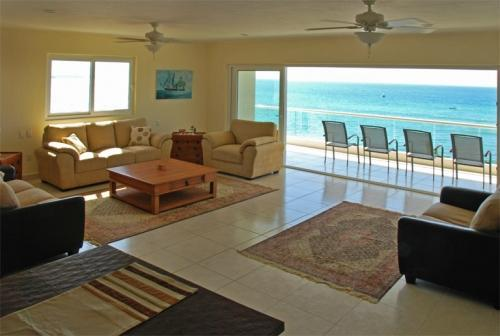 Living room, carpet has been updated to bamboo since this photo - New Beachfront Luxury Condo - Best Deal on Beach - Punta de Mita - rentals