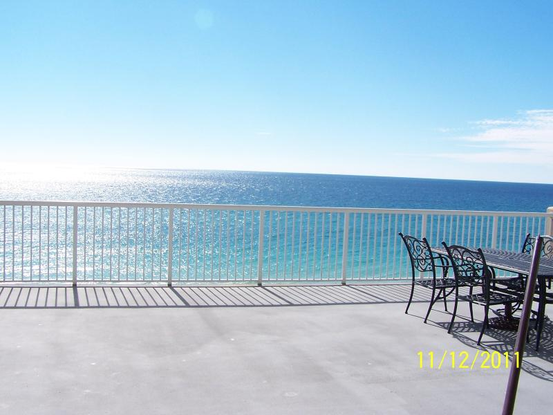 Looking across our large balcony, we have chairs stacked up that you can place in center if you like - PALAZZO106*30x28 balcony *New Carpet* Beach Chairs - Panama City Beach - rentals