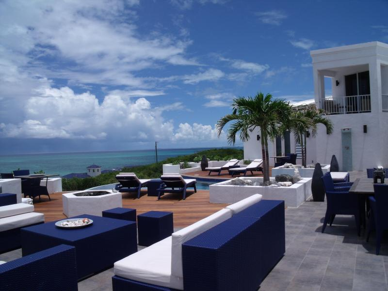 Deck with a view - Luxury home, infinity pool and ocean views. - Providenciales - rentals
