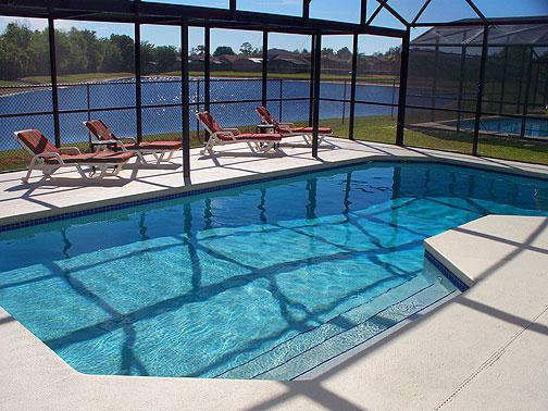 Pool with oversize deck and lake beyond - Herons Flight 4 bedrooms with fantastic lake view - Orlando - rentals