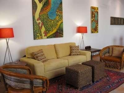 living room  with owners artwork (4 ft. x 5 ft. painting) - Elegant Colonial New Home - GREAT Spring Special! - San Miguel de Allende - rentals