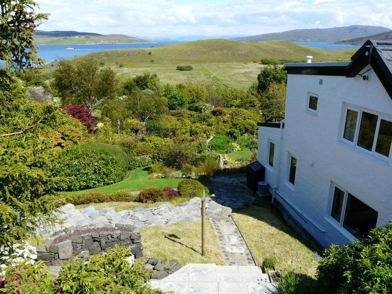 Side of apartment and view down the garden to the Sound of Raasay from the seating area - Braes Retreat Self-Catering Apartment, Portree - Portree - rentals