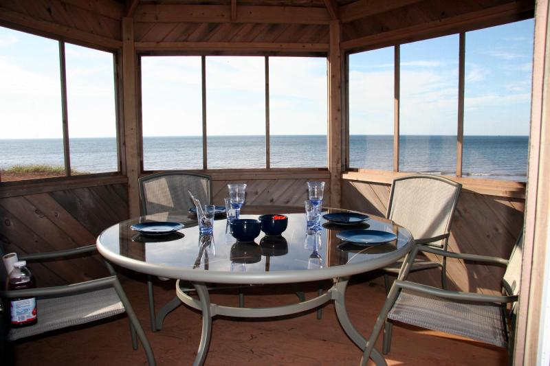 table set for sunset dinner in the gazebo - Garnet Shores Beach House PEI Prince Edward Island - Prince Edward Island - rentals