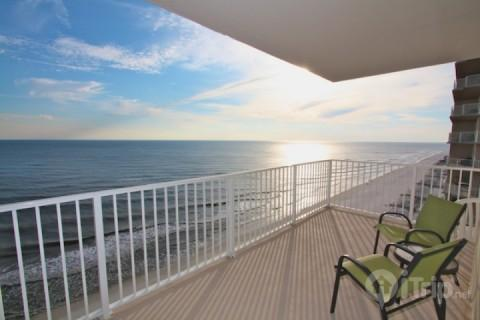 balcony view to the west/2 chairs and small table - Crystal Shores 1207 - Gulf Shores - rentals