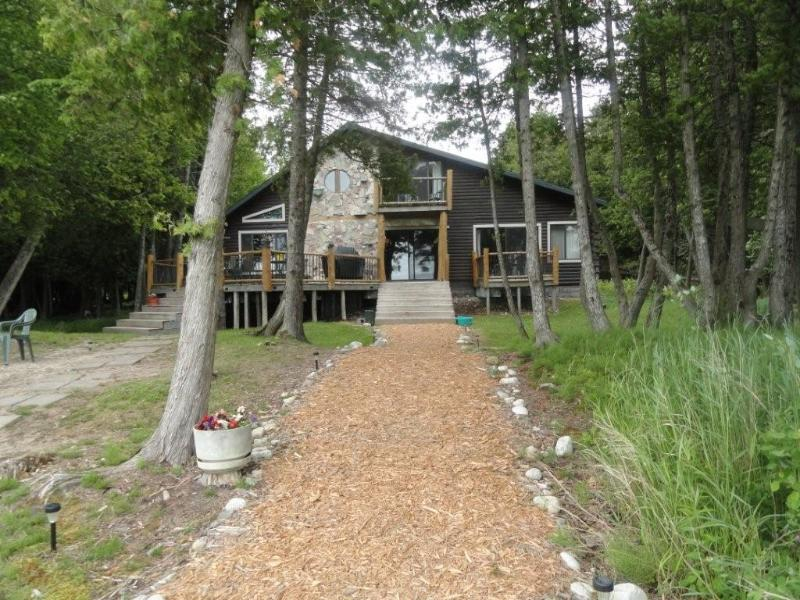 Lakeside of house - Beautiful 5 Bedroom 3 bath log home on Lake Huron - Hessel - rentals