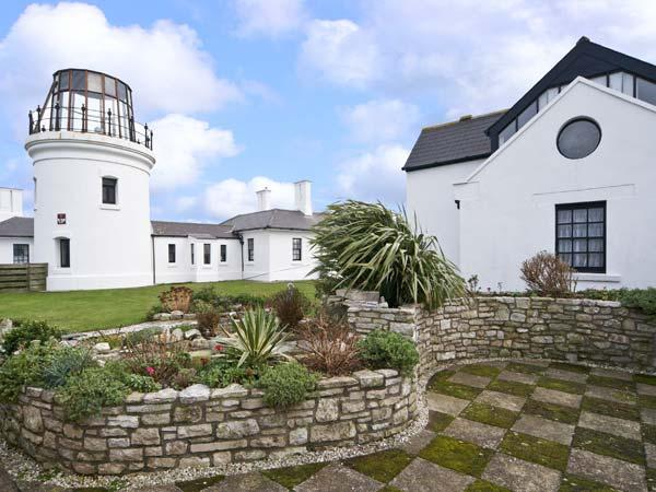 OLD HIGHER LIGHTHOUSE BRANSCOMBE LODGE, family friendly, character holiday cottage, with pool in Portland Bill, Ref 12497 - Image 1 - Dorset - rentals