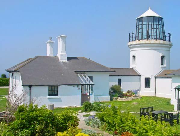 OLD HIGHER LIGHTHOUSE STOPES COTTAGE, family friendly, character holiday cottage, with pool in Portland Bill, Ref 12494 - Image 1 - Dorset - rentals