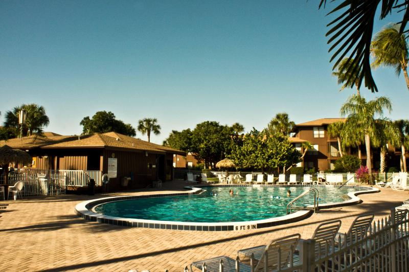 The spacious pool deck offers sun and shade. - 2/2 Renovated Lovely Condo Best Beach on Island! - Sanibel Island - rentals