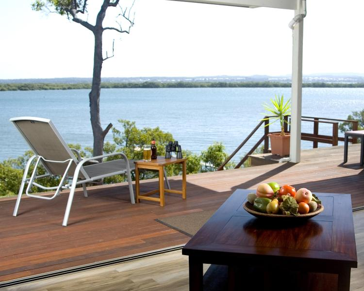 Push back the 14m of glass sliding doors, allowing the waters of Moreton Bay in - Sunset Waters - Luxury WATERFRONT holiday home - Macleay Island - rentals