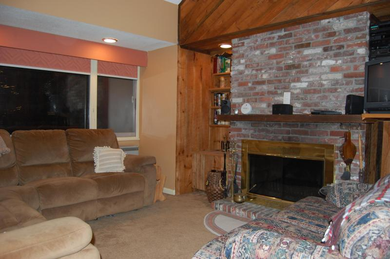 Living room with wood burning fireplace - Waterville Valley NH Vacation Condo - Campton - rentals