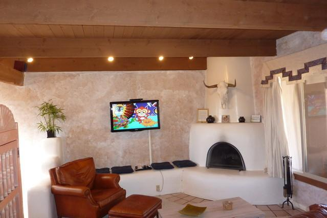 Living Room with large screen Digital TV and Kiva fireplace - Authentic Santa Fe+Walk to Plaza - Santa Fe - rentals