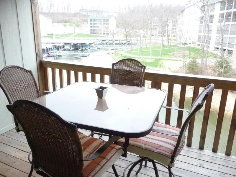Outdoor dining area on deck - Lake Front 1 Bedroom Condo - Indoor Pool - Lake Ozark - rentals