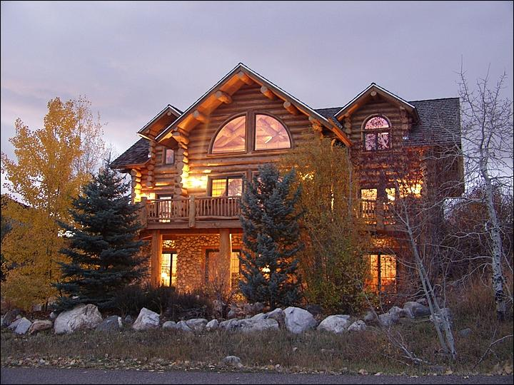 Exterior Front View of this 3-Level, Custom Built Log Home shows mature landscaping & a wraparound front deck with Hot Tub & outdoor dining. - Large, Luxurious Log Home - Custom Architecture, Upscale Amenities (2235) - Steamboat Springs - rentals